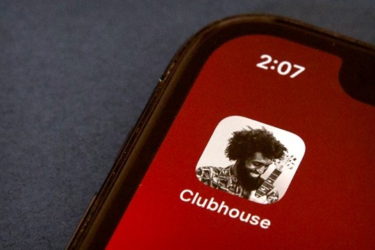 The icon for the social media app Clubhouse is seen on a smartphone screen in Beijing