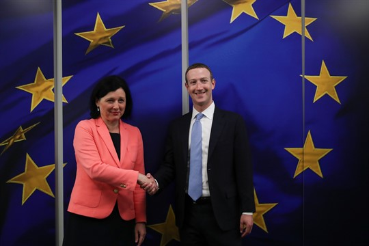 Facebook CEO Mark Zuckerberg is greeted by European Commissioner for Values and Transparency Vera Jourova