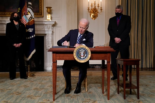 President Joe Biden signs an executive order on climate change in the State Dining Room