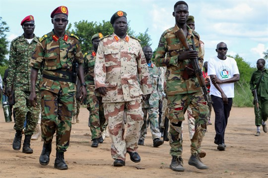 Soldiers walk in formation at an opposition military camp near the town of Nimule, South Sudan