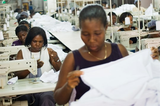 Workers produce clothing items on the assembly line at an apparel factory in Accra, Ghana, 2007