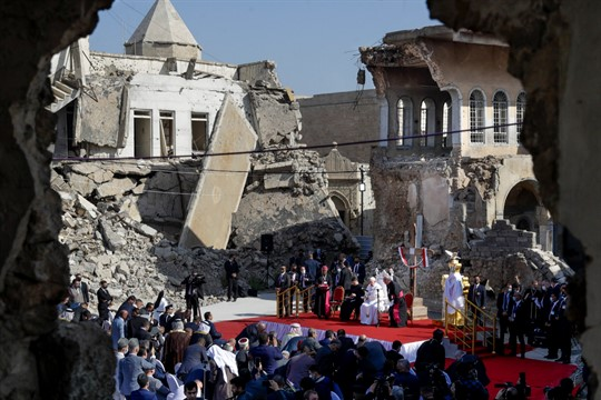 Pope Francis, surrounded by shells of destroyed churches, leads a prayer in Mosul, Iraq