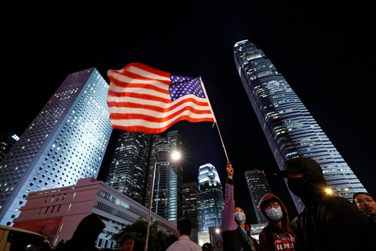 A protester with an American flag in Hong Kong, in 2019