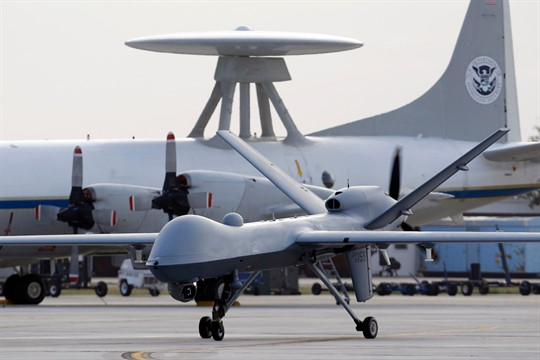 A Predator B unmanned aircraft taxis at the Naval Air Station in Corpus Christi, Texas, 2011