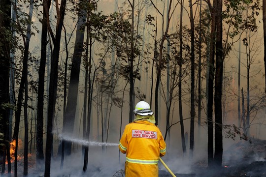 A firefighter manages a controlled burn near Tomerong, Australia, in 2020