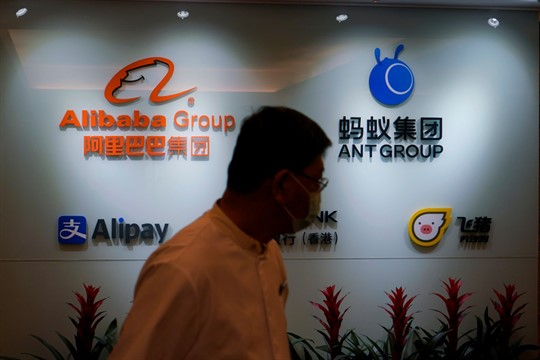 The logos of Ant Group and Alibaba Group at the Ant Group office in Hong Kong
