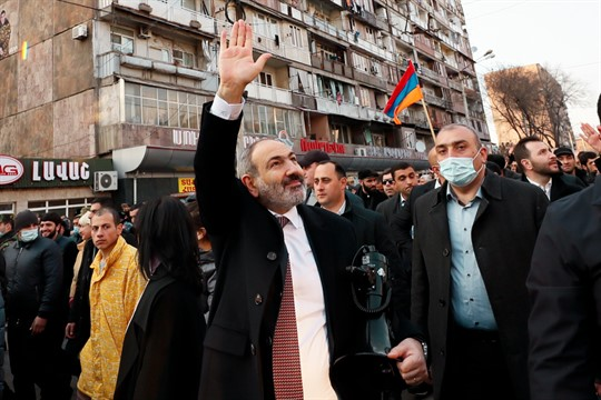 Armenian Prime Minister Nikol Pashinyan waves to supporters during a rally in Yerevan