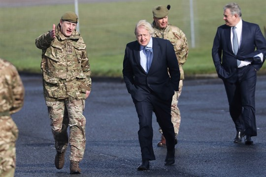 British Prime Minister Boris Johnson visits troops at a helicopter command station in Northern Ireland.