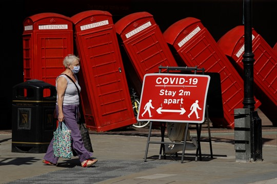 A sign asks people to stay 2 meters apart to try to reduce the spread COVID-19