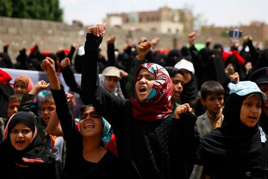 Yemeni girls chant slogans at a protest in front of the U.N. building in Sanaa