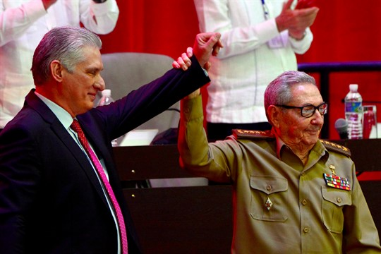 Raul Castro raises the hand of Miguel Diaz-Canel at the Cuban Communist Party congress, in Havana