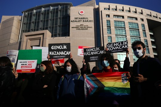 Bogazici University students hold LGBT flags and placards at a protest in Istanbul.
