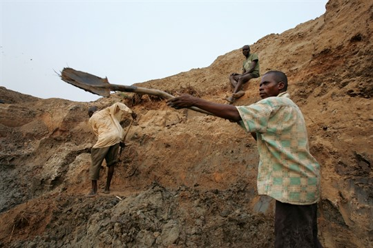 A diamond miner works in a mine in Mbuji Mayi, Congo