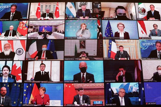 World leaders virtually attend the Leaders Summit on Climate, as seen on a screen