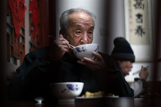 Elderly people have their lunch at a government-funded nursing home in Beijing
