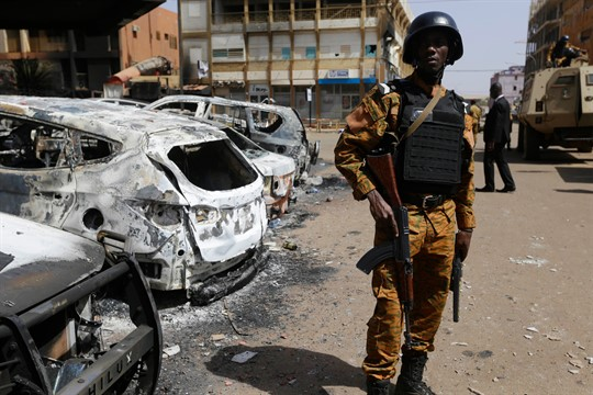 A soldier stands guard outside the site of a terrorist attack in Ouagadougou, Burkina Faso.