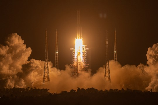 A Long March-5 rocket lifts off from Wenchang Space Center in China.