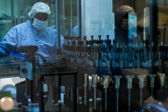 An employee works on the production of AstraZeneca vaccines for COVID-19 in Brazil