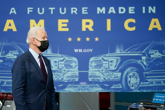 President Joe Biden listens during a tour of the Ford Rouge EV Center in Dearborn, Mich.