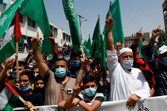 Hamas supporters protest against Palestinian President Mahmoud Abbas' decision to postpone Palestinian elections, in Gaza Strip