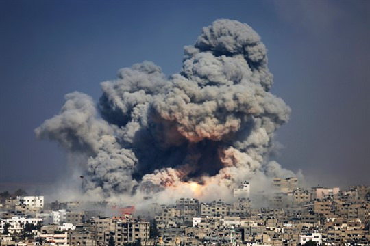 Smoke and fire from an Israeli strike rise over Gaza City