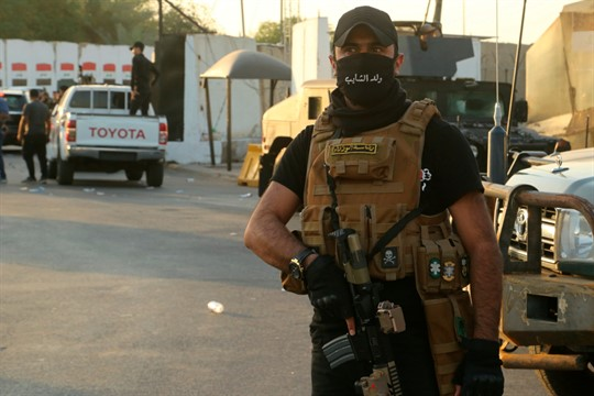 A member of the Popular Mobilization Forces near the heavily fortified Green Zone in Baghdad, Iraq