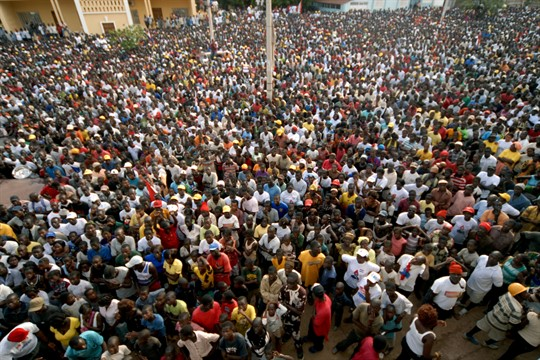 A large crowd gathers to listen to then-presidential candidate Kumba Yala speak in Bissau, 2009