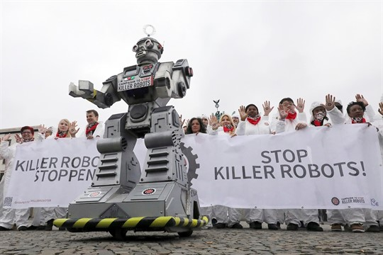 Protesters take part in a Campaign to Ban Killer Robots demonstration in Berlin, Germany