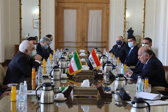Iranian Foreign Minister Mohammad Javad Zarif meets with his Iraqi counterpart, Fuad Hussein, in Tehran.