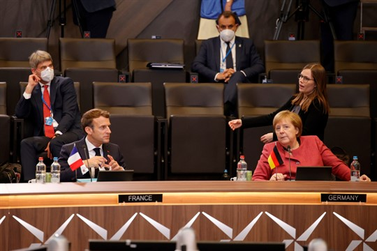 French President Emmanuel Macron and German Chancellor Angela Merkel at the NATO summit in Brussels