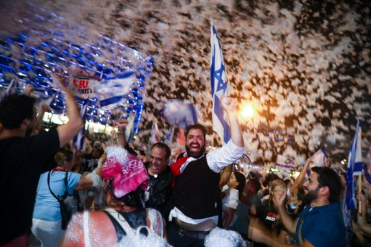 People celebrate the swearing-in of the new government in Tel Aviv, Israel