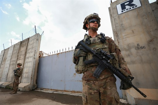 A U.S. soldier stands guard at the K1 Air Base near Kirkuk in northern Iraq