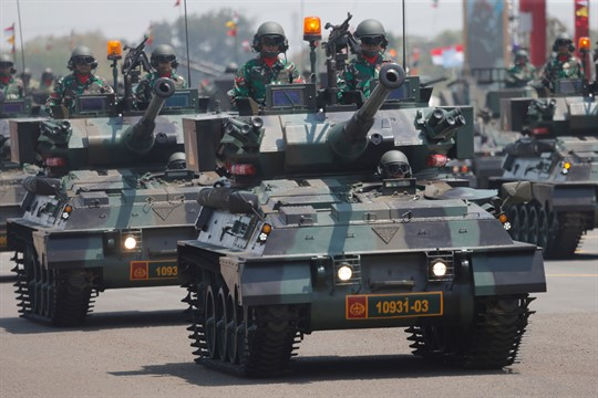 Indonesian soldiers on tanks during a parade marking the 74th anniversary of the Indonesian Armed Forces