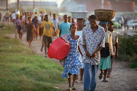 Residents of Port-au-Prince make their way to the downtown market by foot.