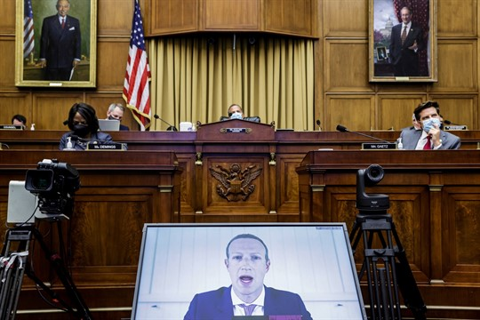 Facebook CEO Mark Zuckerberg speaks via video during a hearing on Capitol Hill in Washington.