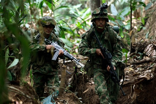 Soldiers patrol during a military operation in rural southern Colombia.