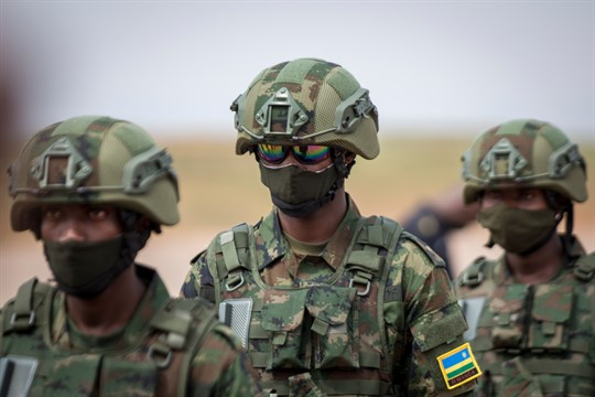 Rwandan armed forces prepare to board a flight to Mozambique, at the airport in Kigali, Rwanda