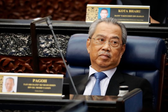 Malaysian Prime Minister Muhyiddin Yassin attends a Parliament session.