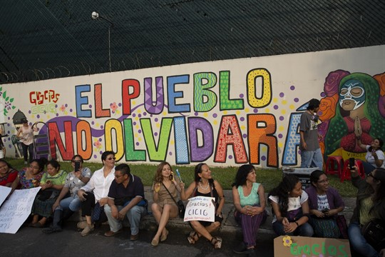 Artists and activists in front of a mural at the CICIG headquarters in Guatemala City.