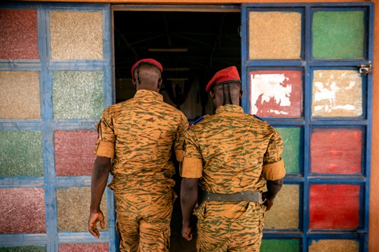 Two soldiers enter the Catholic church at the 10th RCAS army barracks in Kaya, Burkina Faso