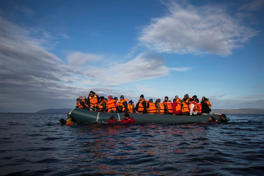 Refugees and migrants on an inflatable vessel off the Greek island of Lesbos.