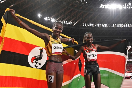 Peruth Chemutai and Hyvin Kiyeng celebrate after the 3,000-meter steeplechase final at the 2020 Olympics.