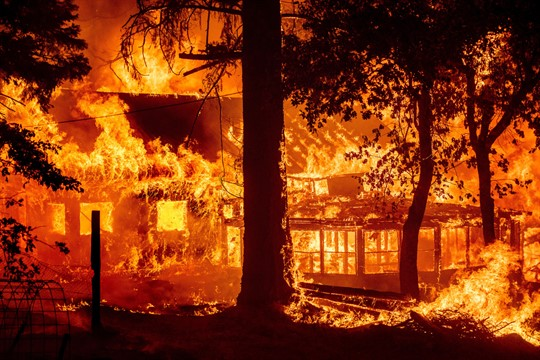 Fire consumes a home in California.