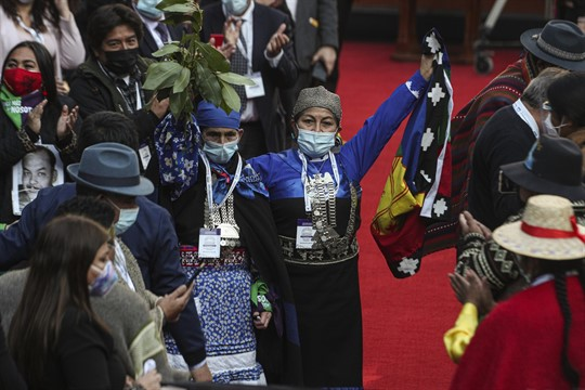 Elisa Loncon, president of the Constituent Assembly, raises a Mapuche flag in Santiago, Chile.