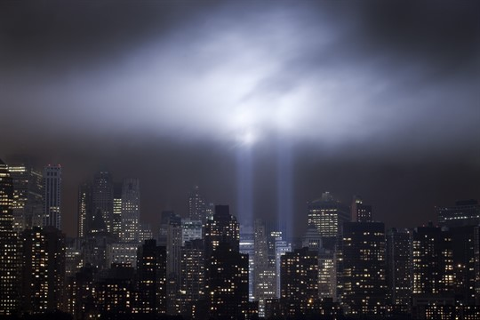 A test of the Tribute in Light rises above lower Manhattan