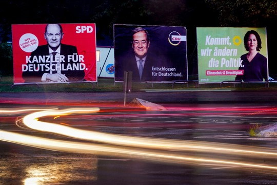 Three election posters showing top candidates for chancellor, in Frankfurt, Germany