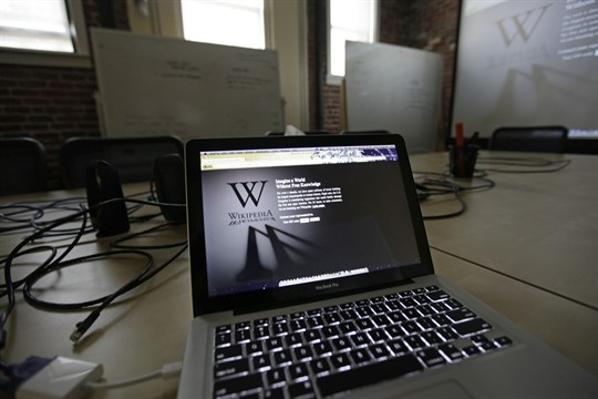 A Wikipedia landing page is displayed on a laptop computer screen.