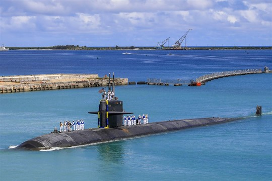 A Los Angeles-class fast attack submarine returns to the U.S. Naval Base in Guam.