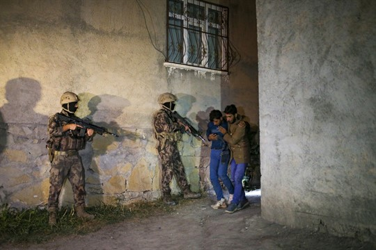 Turkish security forces apprehend a group of migrants in Van, Turkey