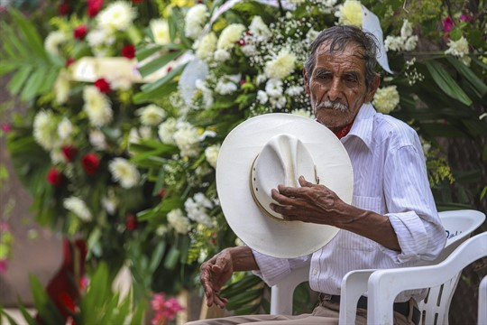 A man removes his hat during the burial of Yaqui Indigenous rights leader Tomas Rojo, Mexico